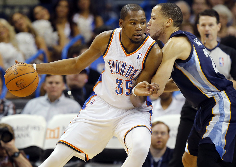 Oklahoma City's Kevin Durant (35) works against Memphis' Tayshaun Prince (21) during an NBA basketball game between the Memphis Grizzlies and the Oklahoma City Thunder at Chesapeake Energy Arena in Oklahoma City, Friday, Feb. 28, 2014. Oklahoma City won, 113-107. Photo by Nate Billings, The Oklahoman