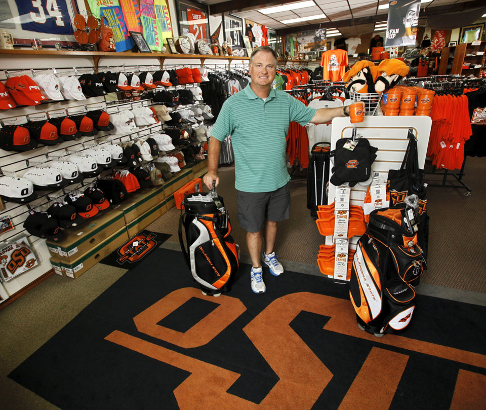 Photo - Chris Norris inside his store, Chris' University Sports, located on Knoblock, on the south edge of the OSU campus.  on Tuesday, June 26, 2012.  Photo by Jim Beckel, The Oklahoman