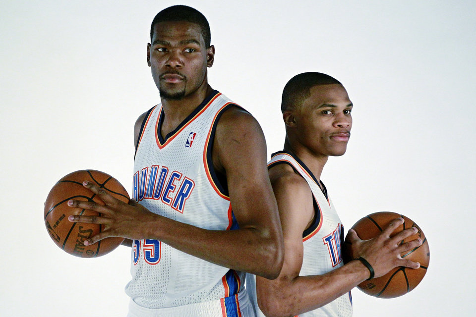Oklahoma City Thunder's Kevin Durant, left, and Russell Westbrook pose for a photo during their NBA basketball media day in Oklahoma City, Monday, Oct. 1, 2012. (AP Photo/Sue Ogrocki) ORG XMIT: OKSO113