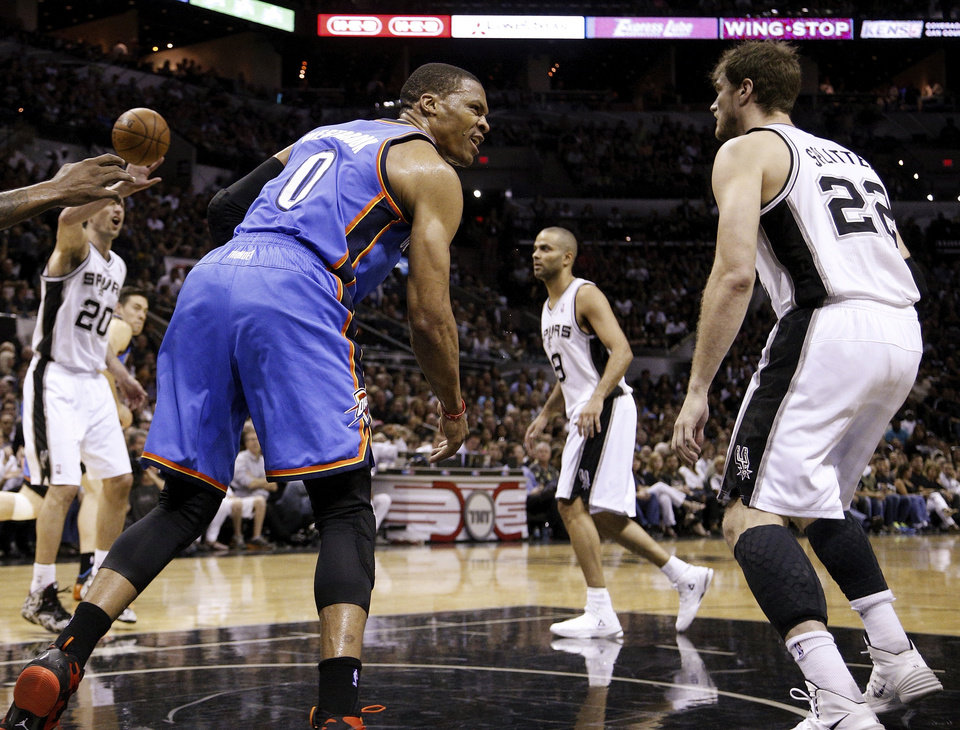 Photo - Oklahoma City's Russell Westbrook (0) reacts after dunking the ball near San Antonio's Tiago Splitter (22) during Game 5 of the Western Conference Finals in the NBA playoffs between the Oklahoma City Thunder and the San Antonio Spurs at the AT&T Center in San Antonio, Thursday, May 29, 2014. Photo by Sarah Phipps, The Oklahoman