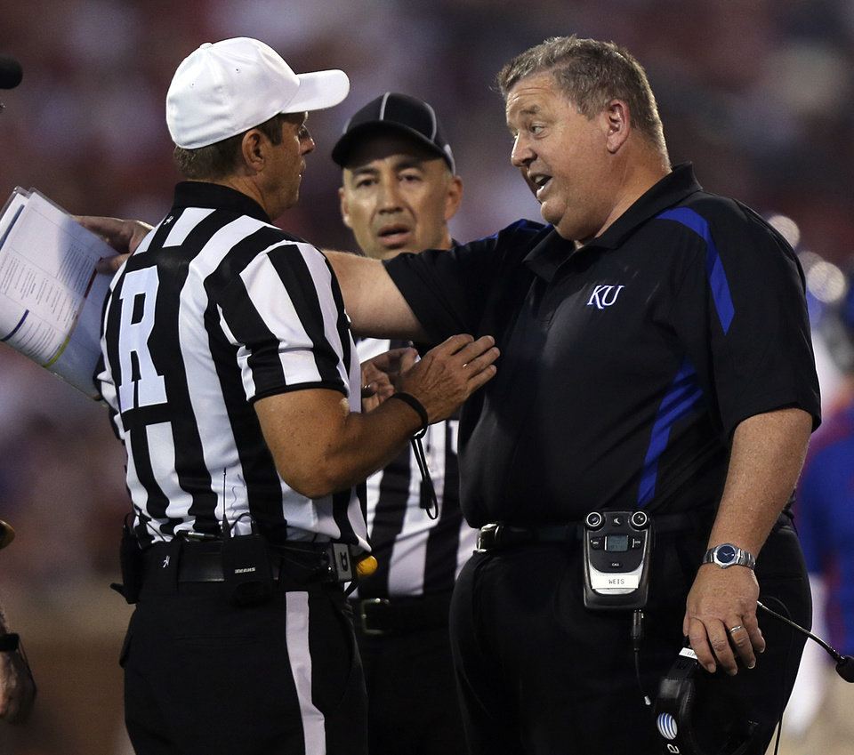 KU's Charlie Weis argues with the officials during the college football game between the University of Oklahoma Sooners (OU) and the University of Kansas Jayhawks (KU) at Gaylord Family-Oklahoma Memorial Stadium on Saturday, Oct. 20th, 2012, in Norman, Okla. Photo by Chris Landsberger, The Oklahoman