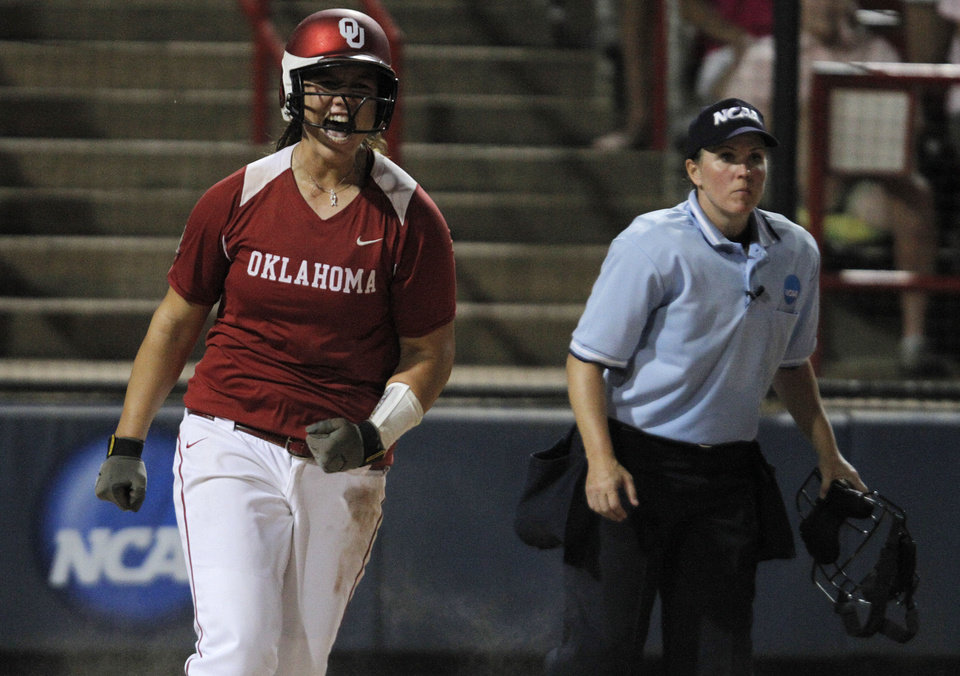 Oklahoma's Keilani Ricketts (10) celebrates after scoring during a Women's College World Series game between OU and Alabama at ASA Hall of Fame Stadium in Oklahoma City, Monday, June 4, 2012.  Photo by Garett Fisbeck, The Oklahoman