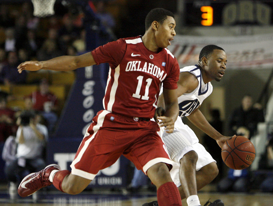 Oral Roberts' D.J. Jackson, right, moves down court under pressure from Oklahoma's Isaiah Cousins, left, during a basketball game at Oral Roberts University in Tulsa, Okla. on Wednesday, Nov. 28, 2012. Photo by Matt Barnard, Tulsa World