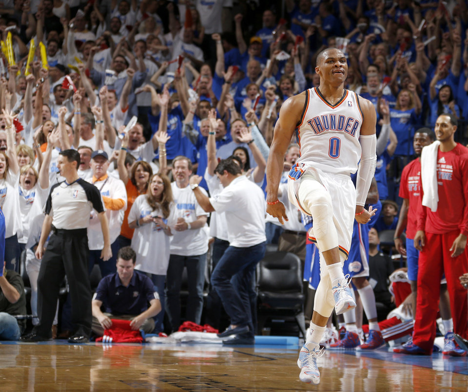 Photo - Oklahoma City's Russell Westbrook (0) celebrates after a basket during Game 2 of the Western Conference semifinals in the NBA playoffs between the Oklahoma City Thunder and the Los Angeles Clippers at Chesapeake Energy Arena in Oklahoma City, Wednesday, May 7, 2014. Photo by Bryan Terry, The Oklahoman