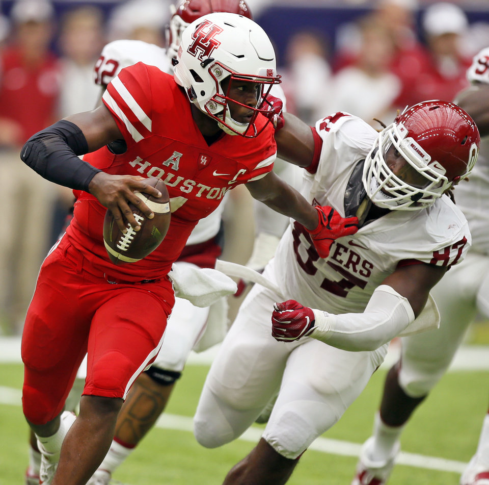Photo - Houston's Greg Ward Jr. (1) scrambles away from Oklahoma's D.J. Ward (87) during the AdvoCare Texas Kickoff college football game between the University of Oklahoma Sooners (OU) and the Houston Cougars at NRG Stadium in Houston, Saturday, Sept. 3, 2016. Photo by Nate Billings, The Oklahoman