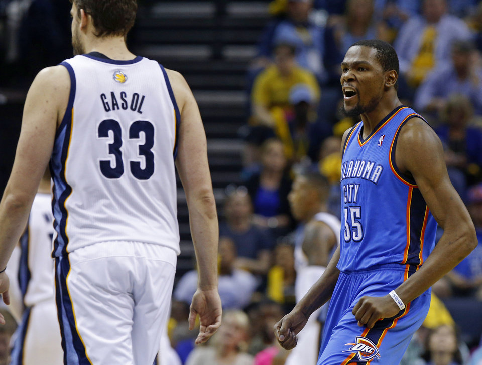 Oklahoma City's Kevin Durant (35) celebrates beside Memphis' Marc Gasol (33) after a dunk during Game 6 in the first round of the NBA playoffs between the Oklahoma City Thunder and the Memphis Grizzlies at FedExForum in Memphis, Tenn., Thursday, May 1, 2014. Oklahoma City won 104-84. Photo by Bryan Terry, The Oklahoman