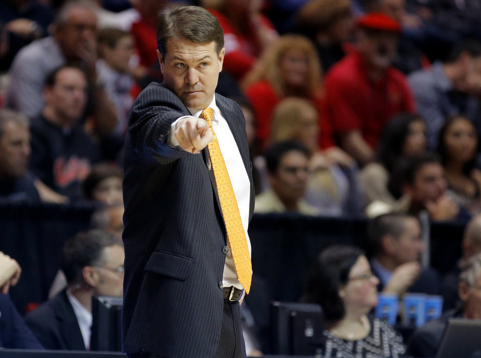 Photo - OSU coach Travis Ford instructs his team during a second round game of the NCAA men's college basketball tournament at Viejas Arena in San Diego, between Oklahoma State and Gonzaga Friday, March 21, 2014. Gonzaga won 85-77. Photo by Bryan Terry, The Oklahoman
