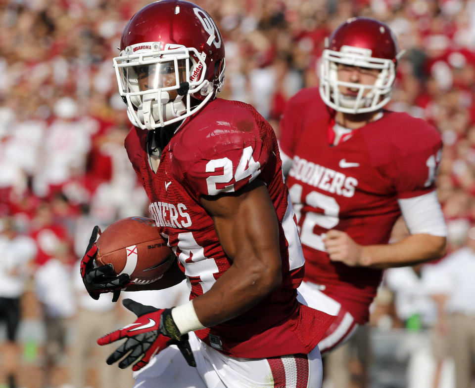 Oklahoma Sooners\'s Brennan Clay (24) scores in the first quarter during the college football game between the University of Oklahoma Sooners (OU) and the Baylor University Bears (BU) at Gaylord Family-Oklahoma Memorial Stadium in Norman, Okla., Saturday, Nov. 10, 2012. Photo by Steve Sisney, The Oklahoman