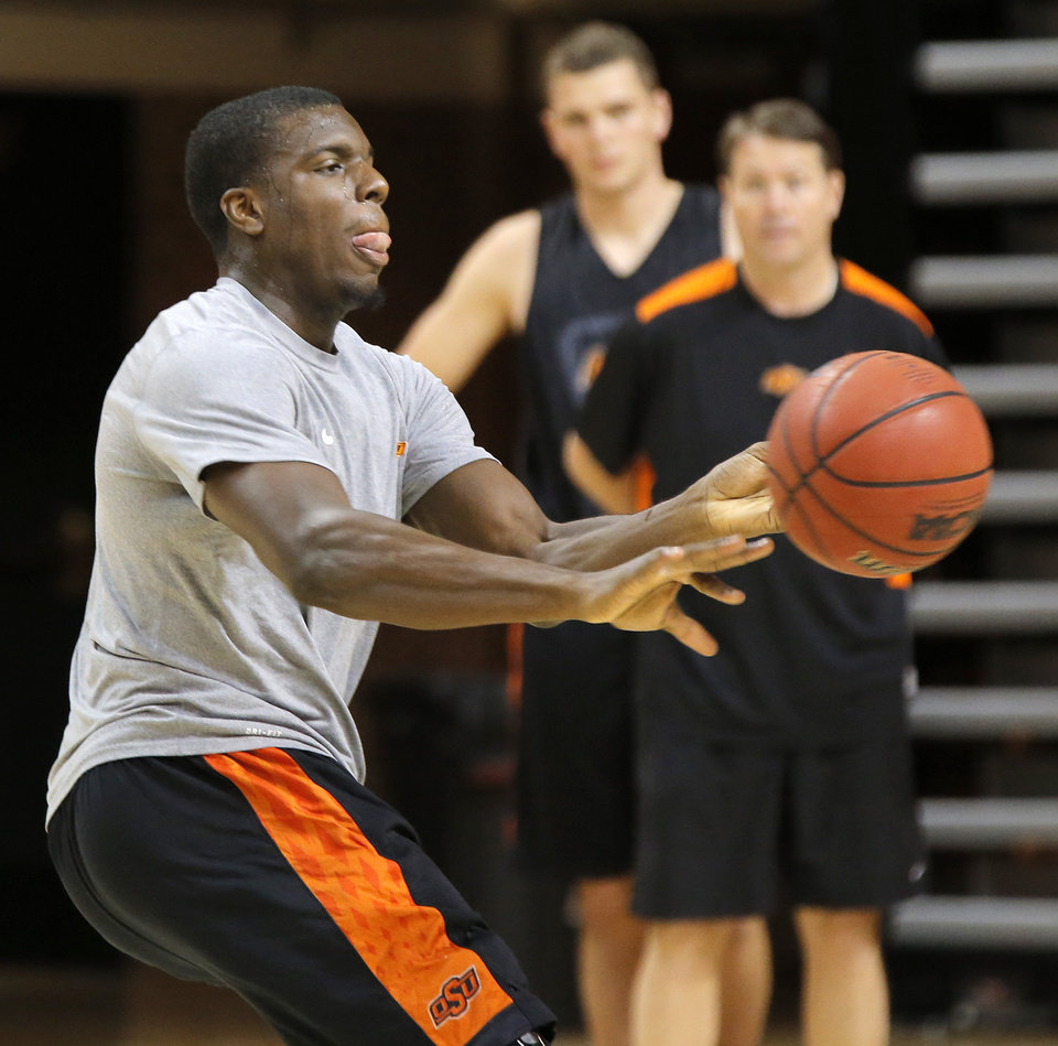 Photo - OSU COLLEGE BASKETBALL: Jean-Paul Olukemi (0) passes the ball during men's basketball practice for the Oklahoma State University Cowboys at Gallagher-Iba Arena in Stillwater, Okla., Monday, Oct. 22, 2012. Photo by Nate Billings, The Oklahoman