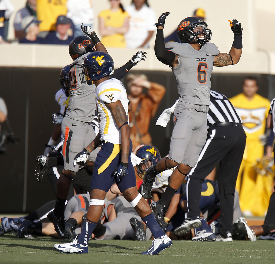 Photo - CELEBRATION: Oklahoma State's Ashton Lampkin (6) celebrates after an OSU fumble recovery during a college football game between Oklahoma State University (OSU) and West Virginia University at Boone Pickens Stadium in Stillwater, Okla., Saturday, Nov. 10, 2012. Oklahoma State won 55-34. Photo by Bryan Terry, The Oklahoman