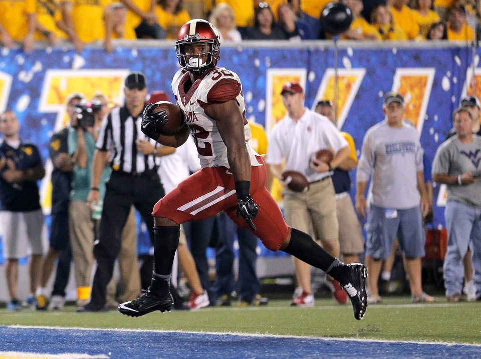 Photo - Oklahoma's Samaje Perine (32) scores a touchdown during the college football game between West Virginia  Mountaineers and the University of Oklahoma Sooners at Milan Puskar Stadium in Morgantown, W.Va., Saturday, Sept. 20, 2014. Photo by Sarah Phipps, The Oklahoman