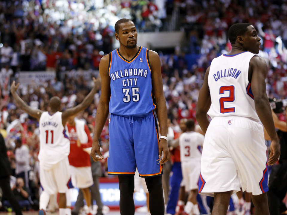 Oklahoma City's Kevin Durant (35) walks slowly to the bench for timeout after Los Angeles' Darren Collison (2) dunked the ball in the fourth quarter during Game 4 of the Western Conference semifinals in the NBA playoffs between the Oklahoma City Thunder and the Los Angeles Clippers at the Staples Center in Los Angeles, Sunday, May 11, 2014. The Clippers won 101-99. Photo by Nate Billings, The Oklahoman