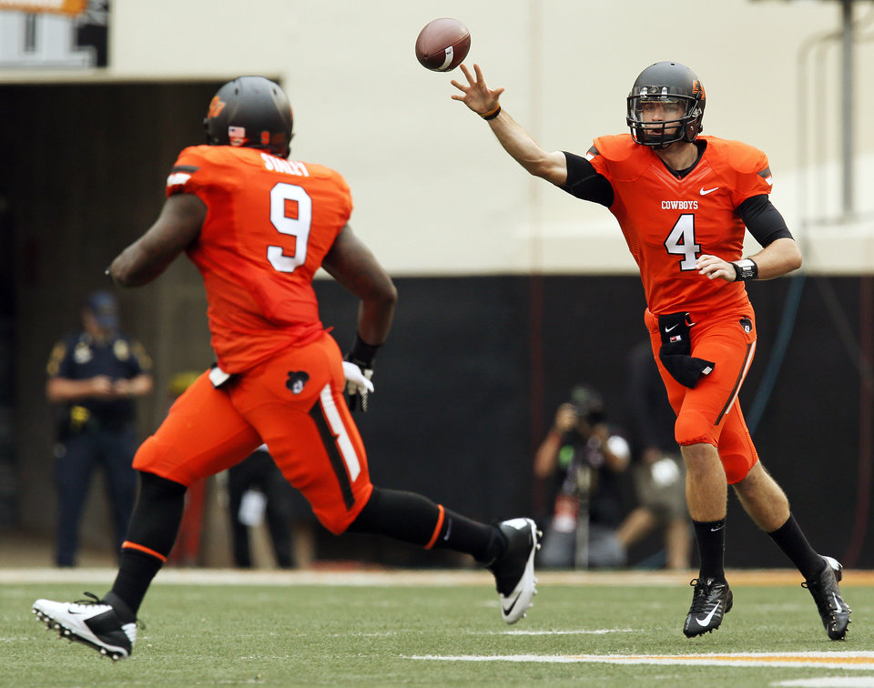 OSU quarterback J.W. Walsh (4) passes the ball to Kye Staley (9) in the first quarter during a college football game between Oklahoma State University (OSU) and the University of Louisiana-Lafayette (ULL) at Boone Pickens Stadium in Stillwater, Okla., Saturday, Sept. 15, 2012. Staley took the ball 52 yards for a touchdown. Photo by Nate Billings, The Oklahoman