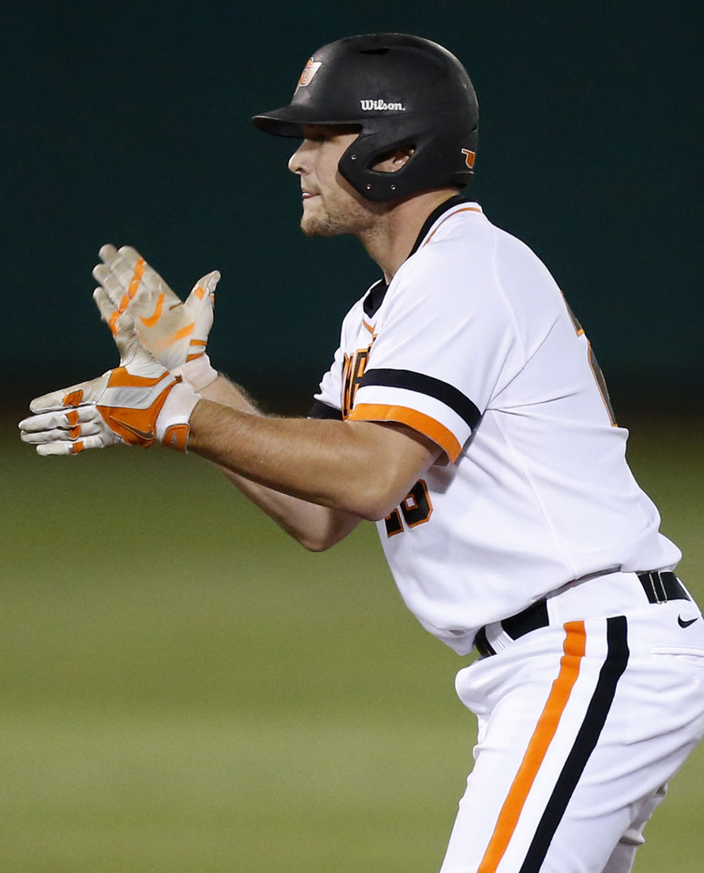 Photo - OSU's Zach Fish (26) reacts after a double in the 3rd inning during Game 1 of the NCAA baseball Stillwater Super Regional between Oklahoma State and UC Irvine at Allie P. Reynolds Stadium in Stillwater, Okla., Friday, June 6, 2014. Photo by Nate Billings, The Oklahoman