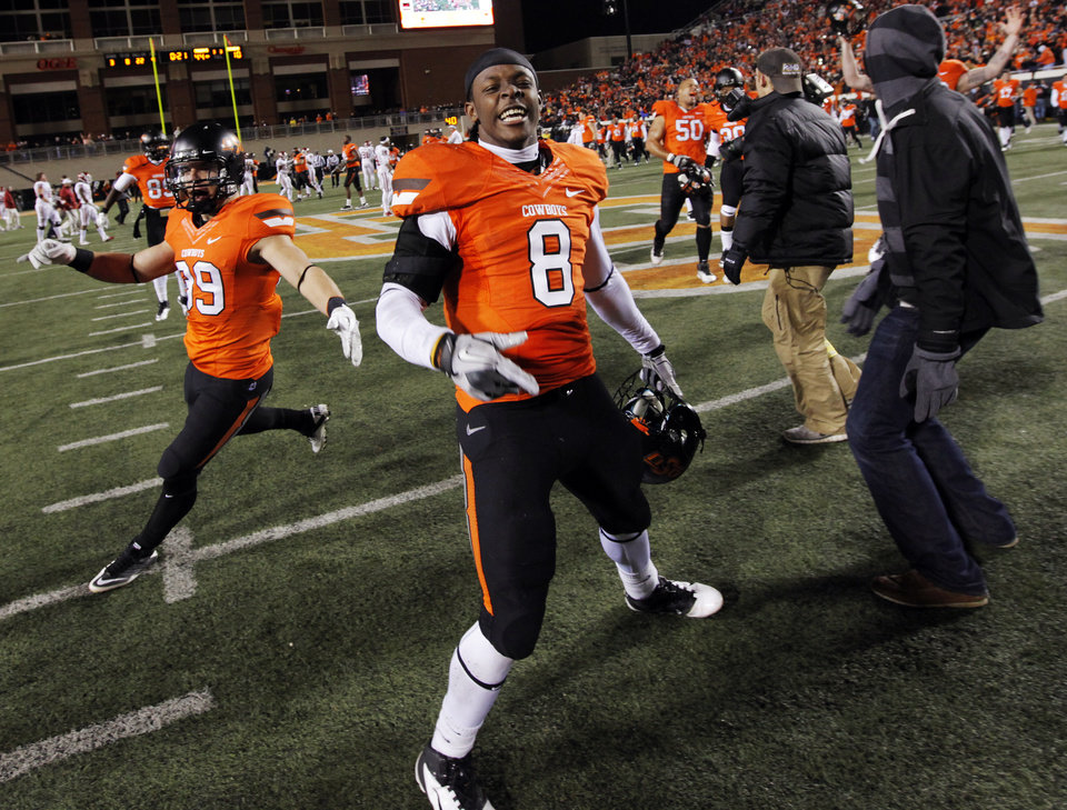 Photo - OSU's Daytawion Lowe (8) reacts at the end of the Bedlam college football game between the Oklahoma State University Cowboys and the University of Oklahoma Sooners at Boone Pickens Stadium in Stillwater, Okla., Saturday, Dec. 3, 2011. OSU beat OU, 44-10. Photo by Nate Billings, The Oklahoman