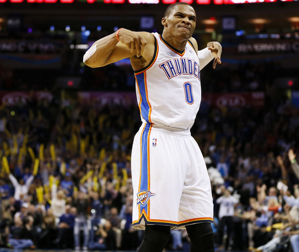 Oklahoma City's Russell Westbrook (0) reacts after making a 3-point shot in the fourth quarter during an NBA basketball game between the Oklahoma City Thunder and the Denver Nuggets at Chesapeake Energy Arena in Oklahoma City, Monday, Nov. 18, 2013. OKC won, 115-113. Photo by Nate Billings, The Oklahoman