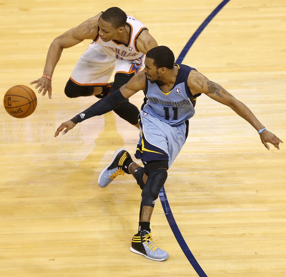 Photo - Oklahoma City's Russell Westbrook (0) steals the ball from Memphis' Mike Conley (11) late in regulation of Game 5 in the first round of the NBA playoffs between the Oklahoma City Thunder and the Memphis Grizzlies at Chesapeake Energy Arena in Oklahoma City, Tuesday, April 29, 2014. Photo by Nate Billings, The Oklahoman