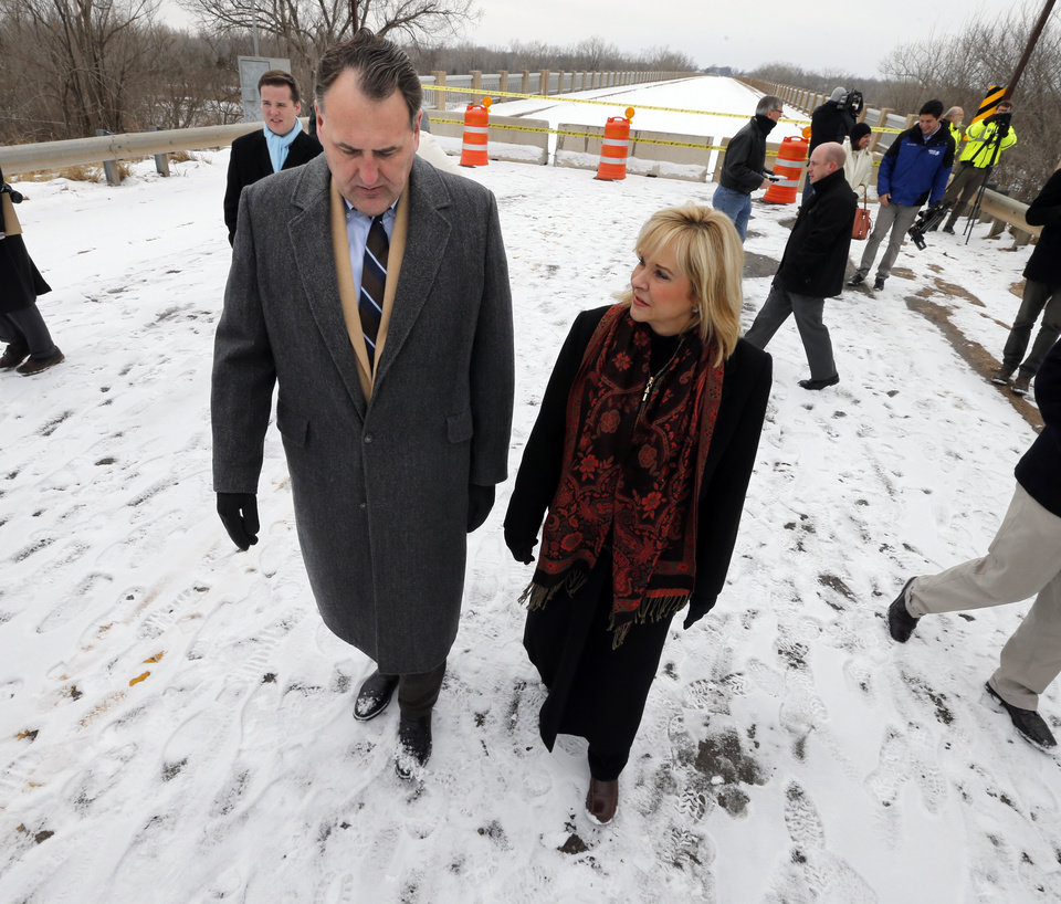 Photo - Senator John Sparks speaks with Governor Mary Fallin as she tours the U.S. 77/SH39 bridge between Purcell and Lexington and announces plans to repair it  on Friday, Feb. 7, 2014 in Lexington, Okla.  Photo by Steve Sisney, The Oklahoman