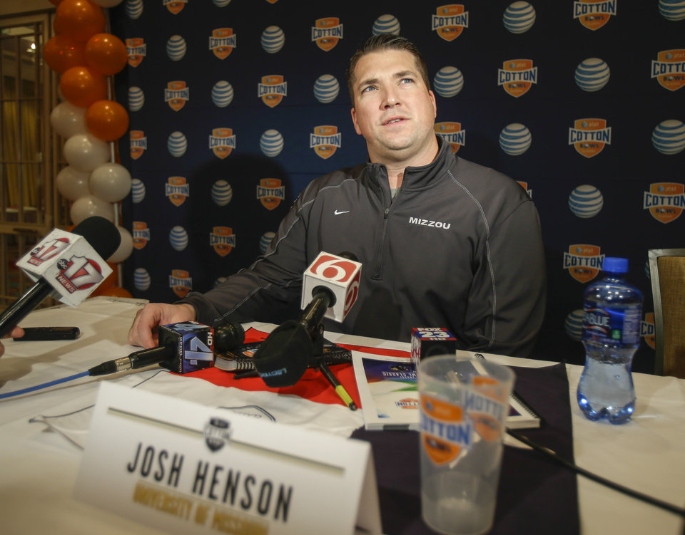 Missouri offensive coordinator Josh Henson talks to reporters during an NCAA college football news conference Tuesday, Dec. 31, 2013, in Irving, Texas. Missouri will play Oklahoma State in the Cotton Bowl on Friday.  (AP Photo/Tim Sharp)