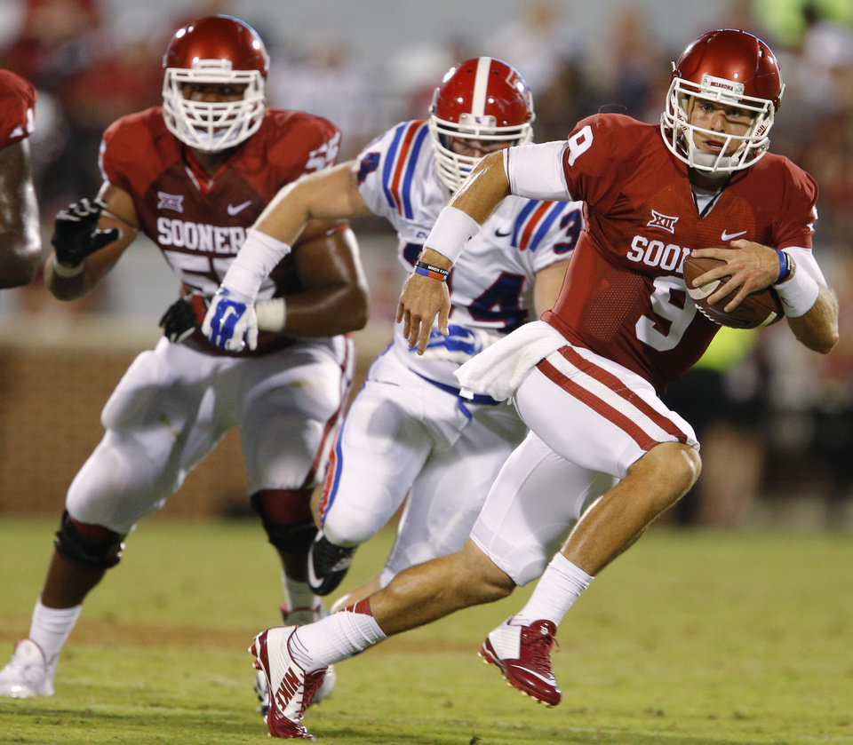 Photo - Oklahoma's Trevor Knight (9) runs during a college football game between the University of Oklahoma Sooners (OU) and the Louisiana Tech Bulldogs at Gaylord Family-Oklahoma Memorial Stadium in Norman, Okla., on Saturday, Aug. 30, 2014. Photo by Bryan Terry, The Oklahoman