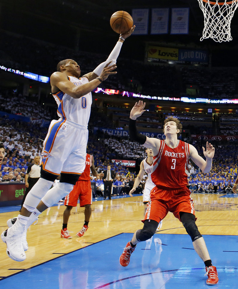 Photo - Oklahoma City's Russell Westbrook (0) shoots against Houston's Omer Asik (3) during Game 2 in the first round of the NBA playoffs between the Oklahoma City Thunder and the Houston Rockets at Chesapeake Energy Arena in Oklahoma City, Wednesday, April 24, 2013. Oklahoma City won, 105-102. Photo by Nate Billings, The Oklahoman