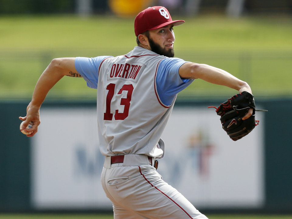 Photo - OU's Dillon Overton (13) pitches during an NCAA baseball game between Oklahoma and Texas Tech in the Big 12 Baseball Championship tournament at the Chickasaw Bricktown Ballpark in Oklahoma City, Friday, May 24, 2013. OU won 8-0. Photo by Nate Billings, The Oklahoman