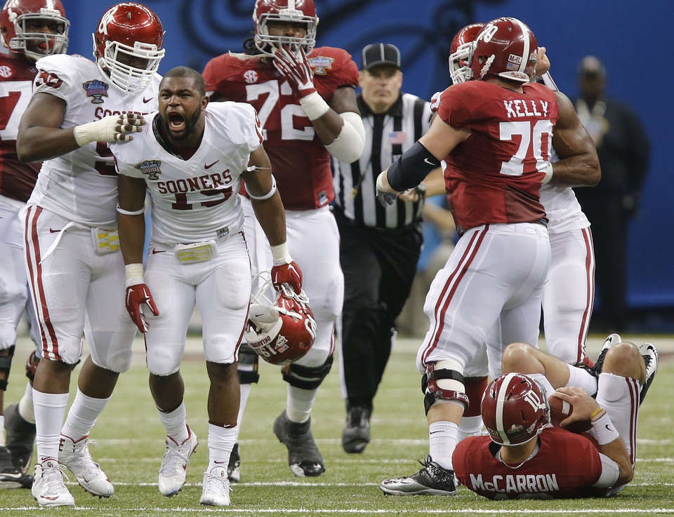 Photo - Oklahoma's Eric Striker (19) reacts after a sack on Alabama's AJ McCarron (10) during the NCAA football BCS Sugar Bowl game between the University of Oklahoma Sooners (OU) and the University of Alabama Crimson Tide (UA) at the Superdome in New Orleans, La., Thursday, Jan. 2, 2014.  .Photo by Chris Landsberger, The Oklahoman
