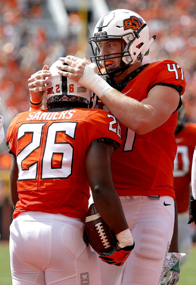 Photo - Oklahoma State tight end Blake Jarwin, right, had four catches for 50 yards in Saturday's win over Texas in Stillwater. (Photo by Sarah Phipps, The Oklahoman)