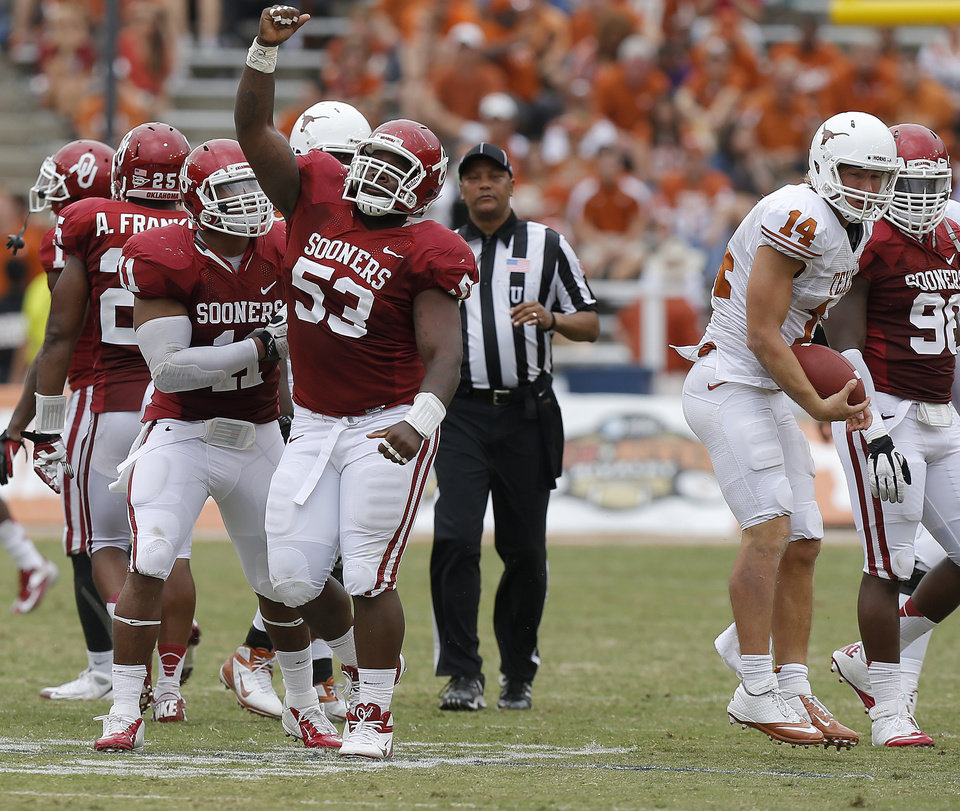 Photo - OU's R.J. Washington (11) and Casey Walker (53) celebrate after bringing down UT's David Ash (14) during the Red River Rivalry college football game between the University of Oklahoma (OU) and the University of Texas (UT) at the Cotton Bowl in Dallas, Saturday, Oct. 13, 2012. Oklahoma won 63-21. Photo by Bryan Terry, The Oklahoman