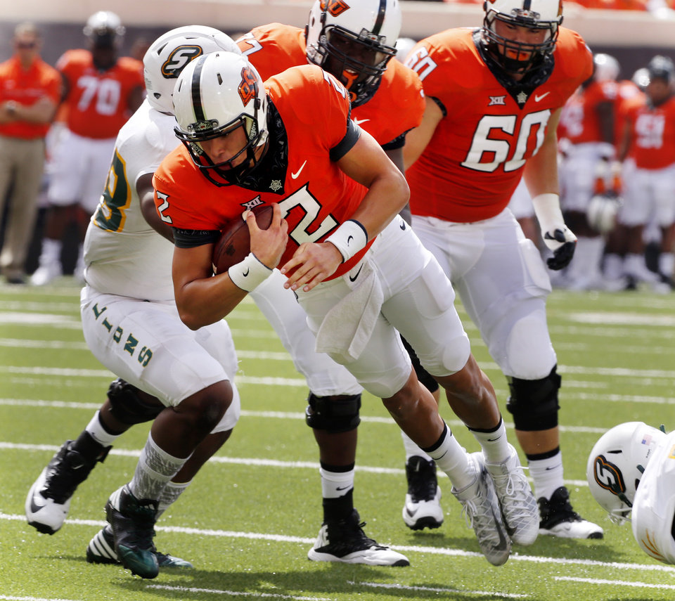Photo - Oklahoma State's Mason Rudolph (2) tries to get to the goal line during the college football game between the Oklahoma State Cowboys (OSU) and the Southeastern Louisiana Lions at Boone Pickens Stadium in Stillwater, Okla., Saturday, Sept. 12, 2015. Photo by Steve Sisney, The Oklahoman