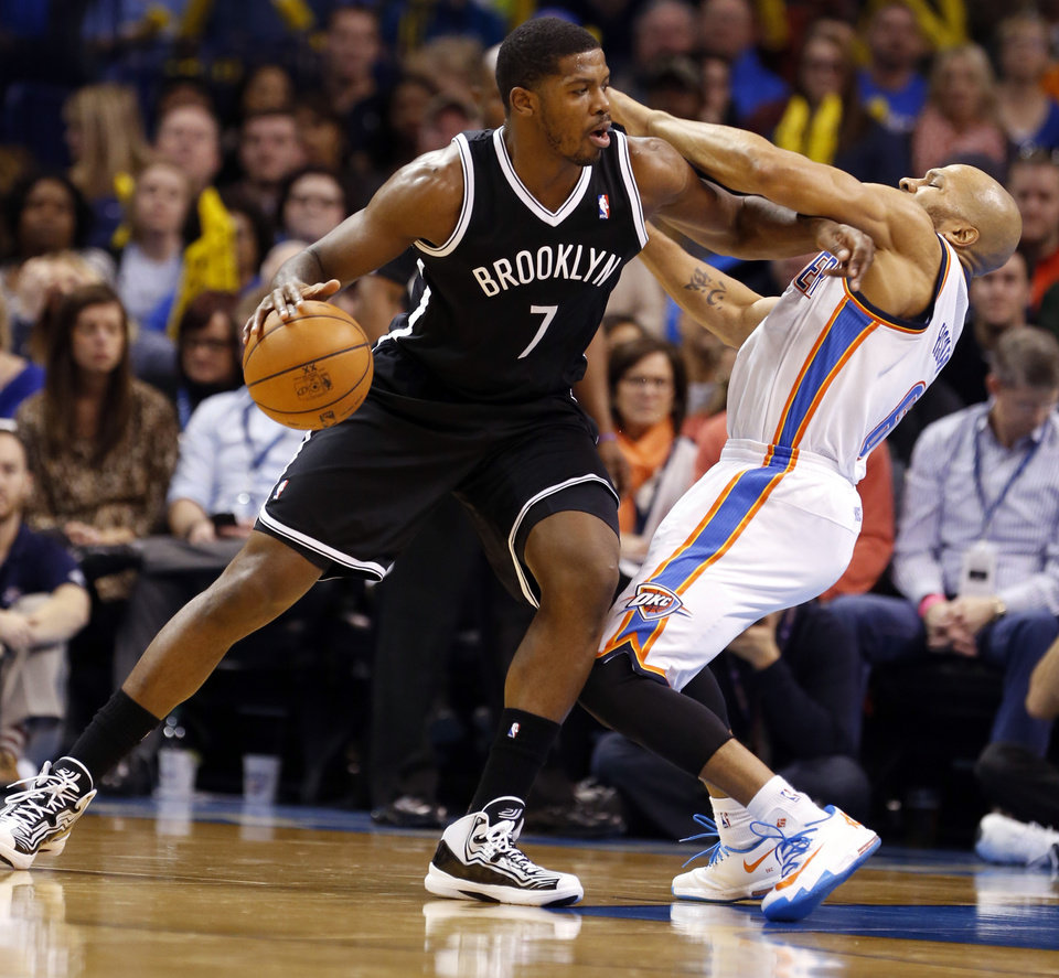 Brooklyn's Joe Johnson (7) gets an offensive foul pushing Thunder's Derek Fisher in the second half of an NBA basketball game where the Oklahoma City Thunder were defeated 95-93 by the Brooklyn Nets at the Chesapeake Energy Arena in Oklahoma City, on Thursday, Jan. 2, 2014. Photo by Steve Sisney, The Oklahoman
