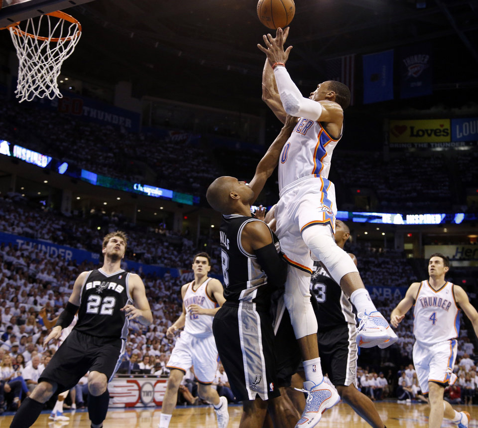 Photo - Oklahoma City's Russell Westbrook (0) goes to the basket as San Antonio's Patty Mills (8) defends during Game 6 of the Western Conference Finals in the NBA playoffs between the Oklahoma City Thunder and the San Antonio Spurs at Chesapeake Energy Arena in Oklahoma City, Saturday, May 31, 2014. Photo by Bryan Terry, The Oklahoman