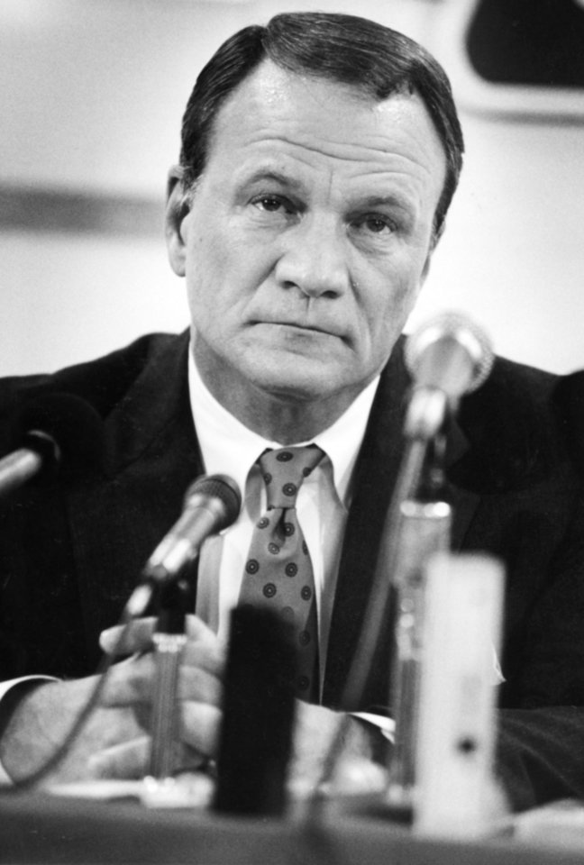 Photo - Under the heat of TV lights, Barry Switzer displays an array of emotions during a June 19, 1989 press conference during which he resigned as head coach at the University of Oklahoma. PHOTO BY STEVE SISNEY, The Oklahoman Archives