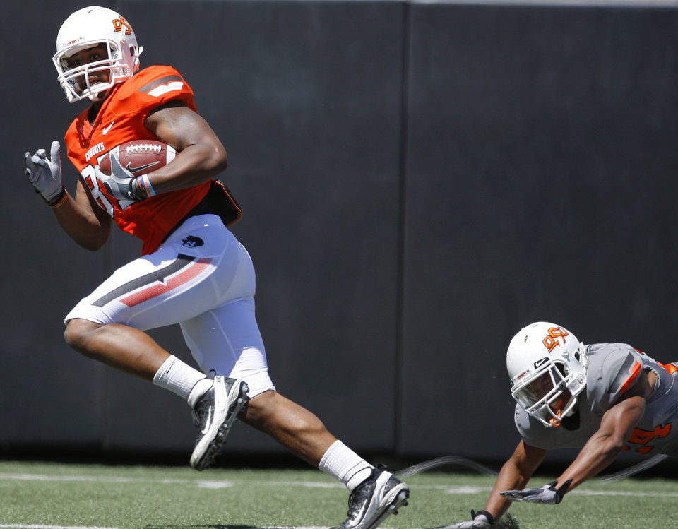 OKLAHOMA STATE UNIVERSITY / OSU / COLLEGE FOOTBALL: OSU\'s Tracy Moore runs for a touchdown after catching the ball in front of Miketavius Jones during Oklahoma State\'s spring football game at Boone Pickens Stadium in Stillwater, Okla., Saturday, April 21, 2012. Photo by Bryan Terry, The Oklahoman