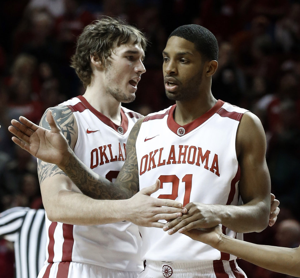 Oklahoma Sooner Ryan Spangler (00) congratulates Cameron Clark (21) in the second half as the University of Oklahoma Sooners (OU) men defeat the Texas Longhorns (TU) 77-65 in NCAA, college basketball at The Lloyd Noble Center on Saturday, March 1, 2014  in Norman, Okla. Photo by Steve Sisney, The Oklahoman