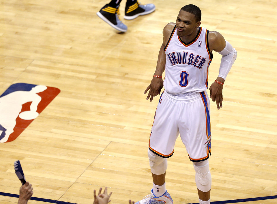 Oklahoma City's Russell Westbrook (0) celebrates a 3-point basket during Game 7 in the first round of the NBA playoffs between the Oklahoma City Thunder and the Memphis Grizzlies at Chesapeake Energy Arena in Oklahoma City, Saturday, May 3, 2014. Photo by Sarah Phipps, The Oklahoman