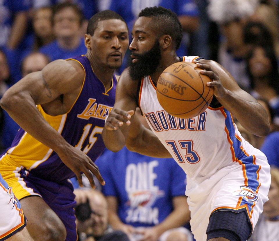 Oklahoma City's James Harden (13) tries to get past Los Angeles' Metta World Peace (15) during Game 1 in the second round of the NBA playoffs between the Oklahoma City Thunder and L.A. Lakers at Chesapeake Energy Arena in Oklahoma City, Monday, May 14, 2012. Photo by Bryan Terry, The Oklahoman