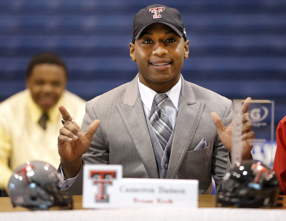 Millwood\'s Cameron Batson signed to play football for Texas Tech during signing day at Millwood High School in Oklahoma City, Wednesday February 05, 2014. Photo By Steve Gooch, The Oklahoman