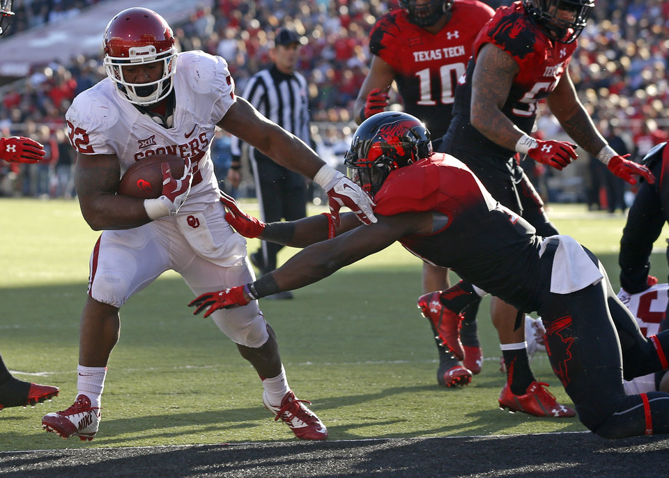 Photo - Oklahoma's Samaje Perine (32) scores a touchdown beside Sam Eguavoen (13) during the college football game between the University of Oklahoma Sooners (OU) and the Texas Tech Red Raiders at Jones AT&T Stadium in Lubbock, Texas, Saturday, November 15, 2014.  Photo by Bryan Terry, The Oklahoman
