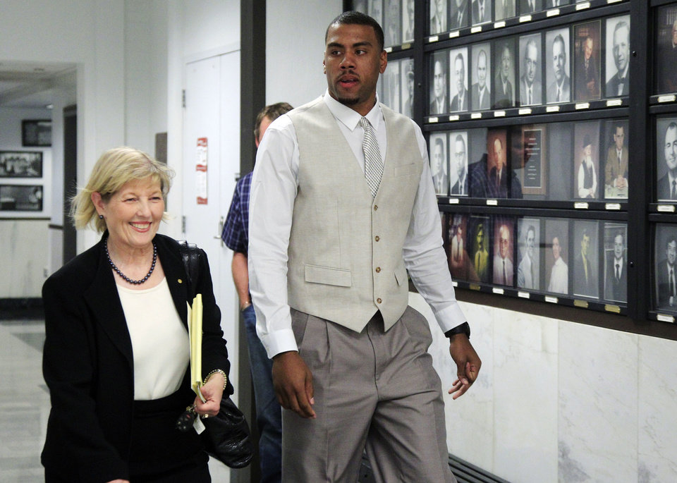 Darrell Williams, right, a suspended Oklahoma State basketball player accused of sexually assaulting two women at a campus party, returns to the courtroom with one of his defense attorneys, Cheryl Ramsey, left, following a break in the first day of jury selection in his trial in Stillwater, Okla., Monday, July 9, 2012. (AP Photo/Sue Ogrocki) ORG XMIT: OKSO104