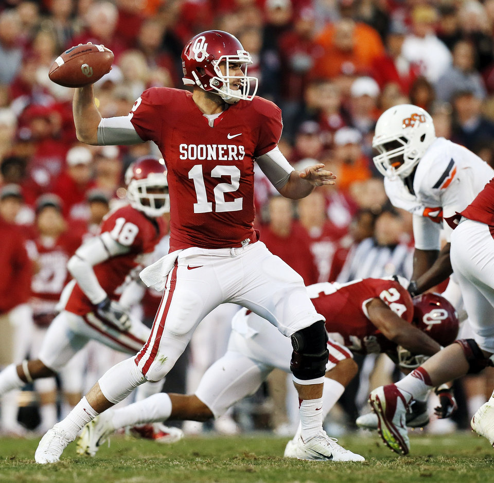 Photo - Oklahoma's Landry Jones (12) passes during the Bedlam college football game between the University of Oklahoma Sooners (OU) and the Oklahoma State University Cowboys (OSU) at Gaylord Family-Oklahoma Memorial Stadium in Norman, Okla., Saturday, Nov. 24, 2012. OU won, 51-48 in overtime. Photo by Nate Billings , The Oklahoman
