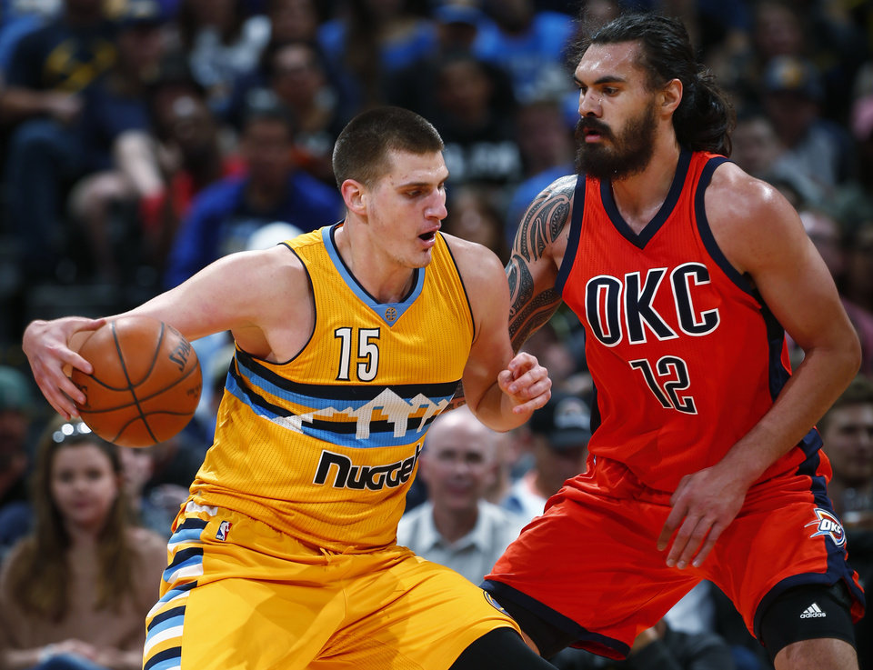 Photo - Denver Nuggets forward Nikola Jokic (15) tries to go around Oklahoma City Thunder center Steven Adams (12) during the first half of an NBA basketball game, Sunday, April 9, 2017, in Denver. (AP Photo/Jack Dempsey)