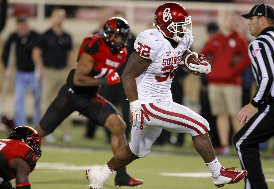 Photo - Oklahoma's Samaje Perine (32) runs for a fourth-quarter touchdown during the college football game between the University of Oklahoma Sooners (OU) and the Texas Tech Red Raiders at Jones AT&T Stadium in Lubbock, Texas, Saturday, November 15, 2014.  Photo by Bryan Terry, The Oklahoman