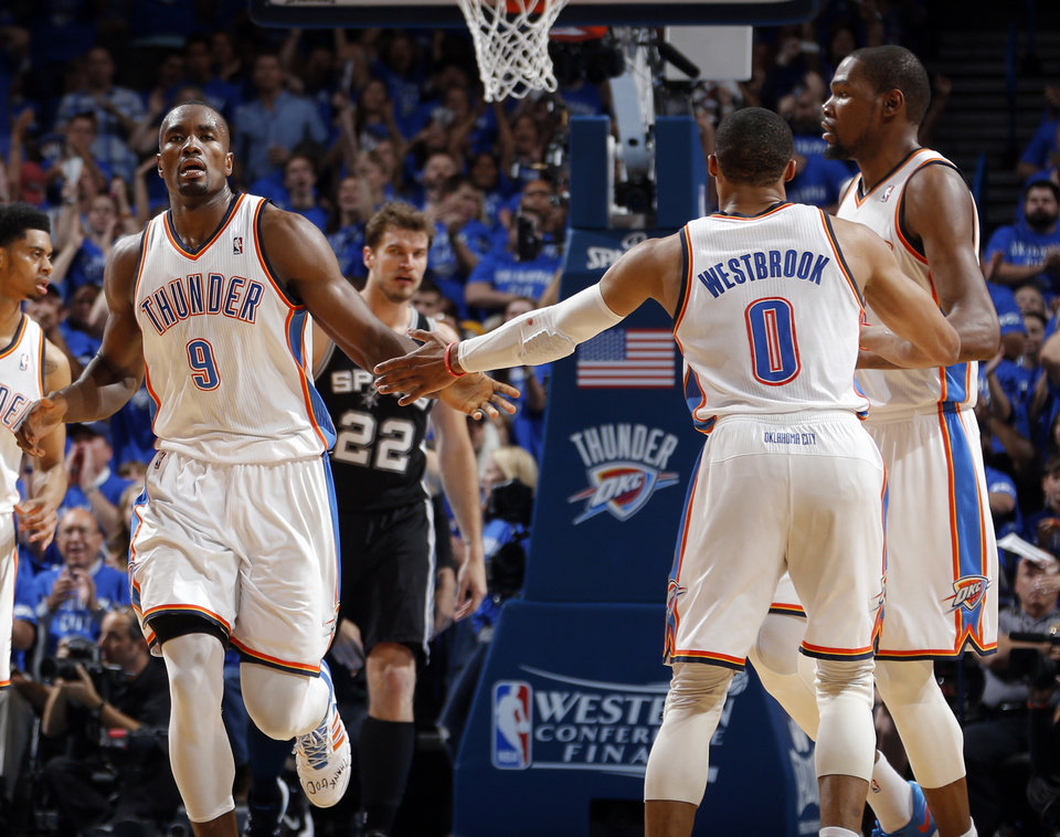 Photo - Oklahoma City's Serge Ibaka (9) celebrates with Russell Westbrook (0) and Kevin Durant (35) during Game 3 of the Western Conference Finals in the NBA playoffs between the Oklahoma City Thunder and the San Antonio Spurs at Chesapeake Energy Arena in Oklahoma City, Sunday, May 25, 2014. Photo by Bryan Terry, The Oklahoman