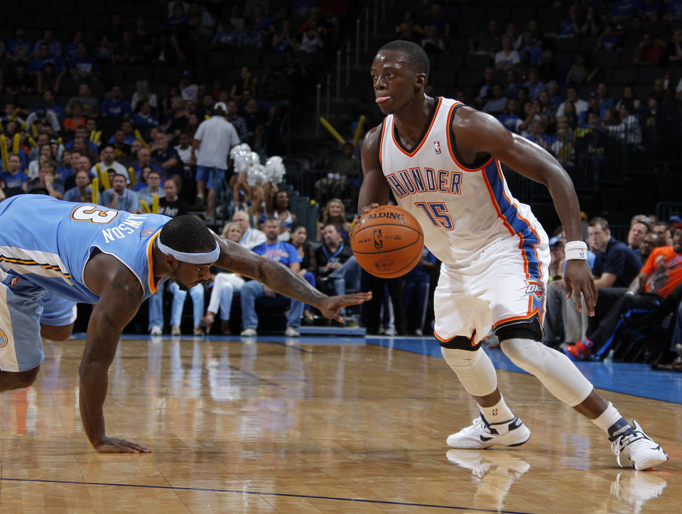 EXHIBITION NBA BASKETBALL GAME: Oklahoma City's Reggie Jackson (15) drives the ball past Denver's Ty Lawson (3) during the NBA preseason basketball game between the Oklahoma City Thunder and the Denver Nuggets at the Chesapeake Energy Arena, Sunday, Oct. 21, 2012. Photo by Garett Fisbeck, The Oklahoman