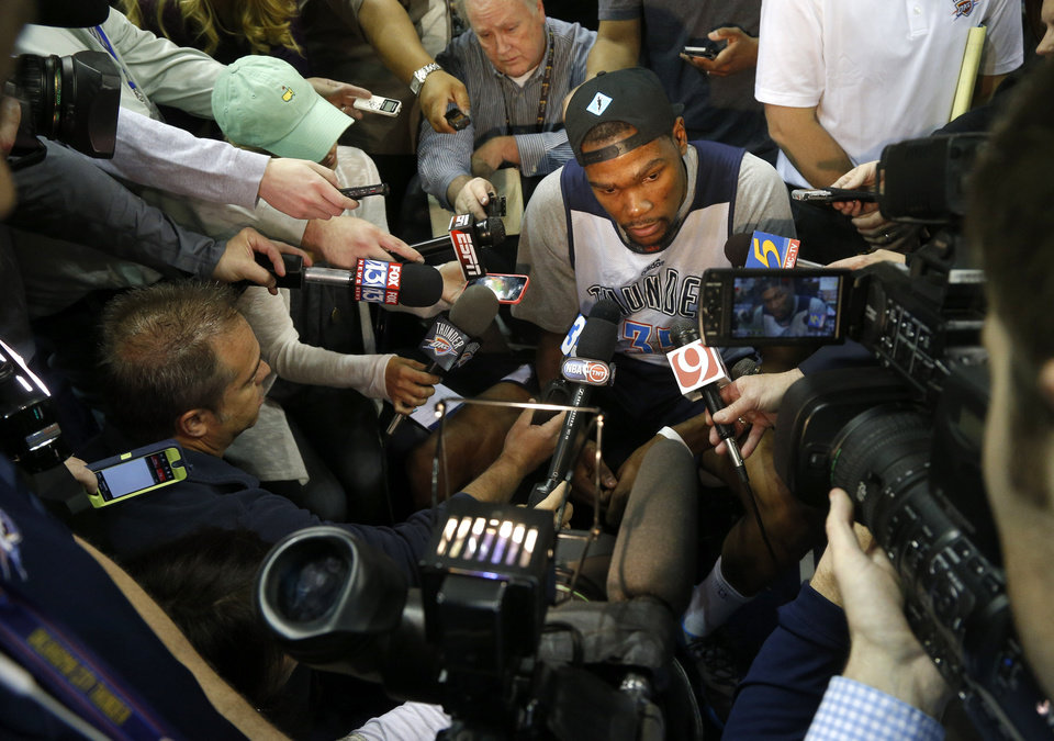 Photo - Oklahoma City's Kevin Durant talks with reporters during a shootaround before Game 6 in the first round of the NBA playoffs between the Oklahoma City Thunder and the Memphis Grizzlies at FedExForum in Memphis, Tenn., Thursday, May 1, 2014. Photo by Bryan Terry, The Oklahoman
