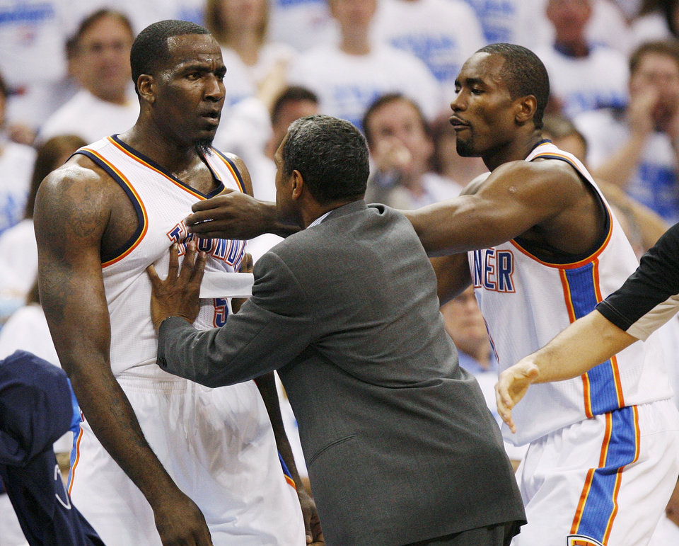 Photo - Oklahoma City's Serge Ibaka (9) and assistant coach Maurice Cheeks hold back Kendrick Perkins (5) from Dirk Nowitzki of Dallas during Game 2 of the first round in the NBA basketball  playoffs between the Oklahoma City Thunder and the Dallas Mavericks at Chesapeake Energy Arena in Oklahoma City, Monday, April 30, 2012. Photo by Nate Billings, The Oklahoman