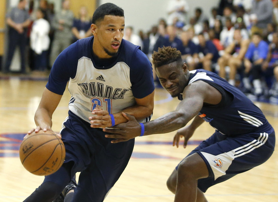 Photo - Oklahoma CIty's Andre Roberson goes past Anthony Morrow shoots during the Thunder's annual Blue and White Scrimmage at John Marshall Mid-High School in Oklahoma City, Tuesday, Sept. 27, 2016. Photo by Bryan Terry, The Oklahoman