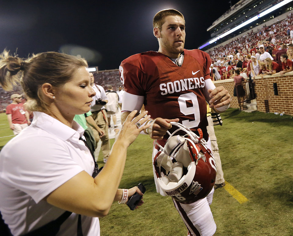 Photo - Oklahoma's Trevor Knight (9) walks off the field after the 34-0 win over Louisiana Monroe during the college football game between the University of Okahoma Sooners (OU) and the University of Louisiana Monroe Warhawks (ULM) at the Gaylord Family Memorial Stadium on Saturday, Aug. 31, 2013 in Norman, Okla.  Photo by Chris Landsberger, The Oklahoman