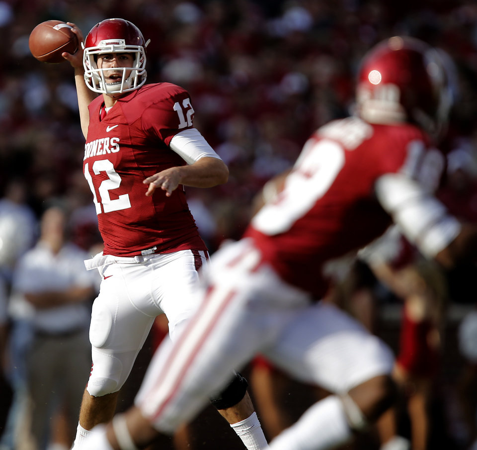 Oklahoma\'s Landry Jones (12) passes the ball during the college football game between the University of Oklahoma Sooners (OU) and Baylor University Bears (BU) at Gaylord Family - Oklahoma Memorial Stadium on Saturday, Nov. 10, 2012, in Norman, Okla. Photo by Chris Landsberger, The Oklahoman